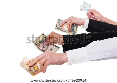 four different hands with the important currencies - stock photo