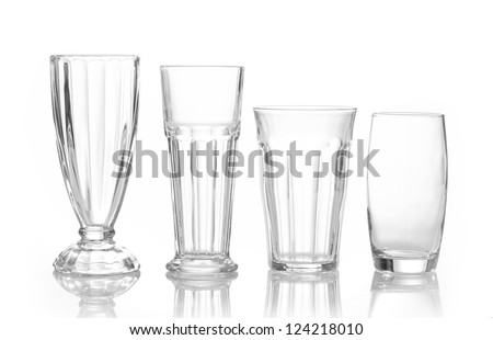 four different juice glasses