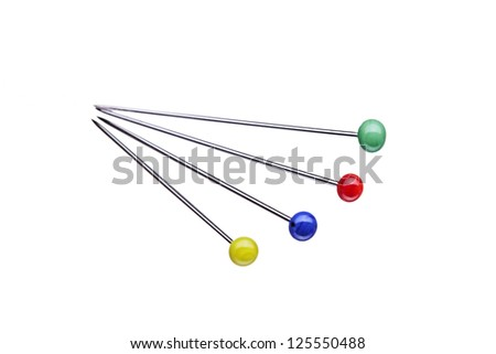 four different sewing pins with round red heads, isolated on white background - stock photo