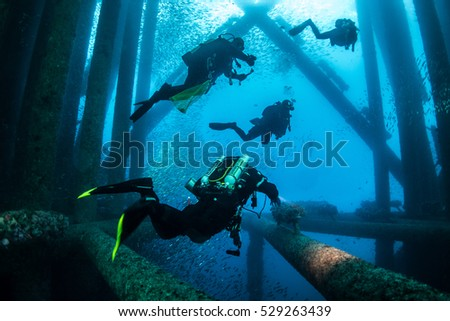Four dive crew on the oil rig
