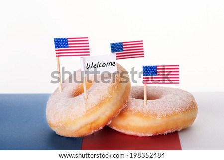 Four Donuts with American Flags and a Welcome Flag