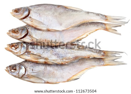 four dried salt fishes isolated on white background