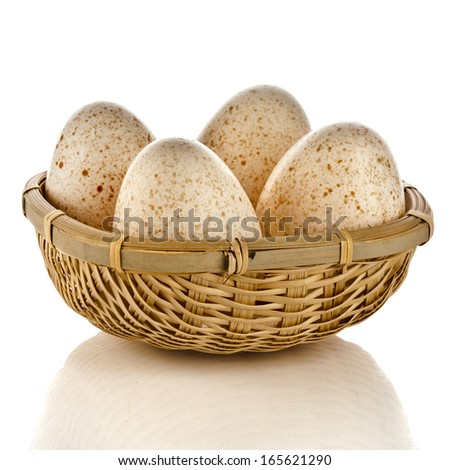 Four Eggs in basket  isolated on white background with clipping path  - stock photo