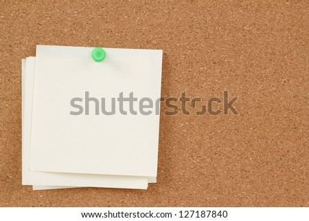 four empty note papers on cork board - stock photo