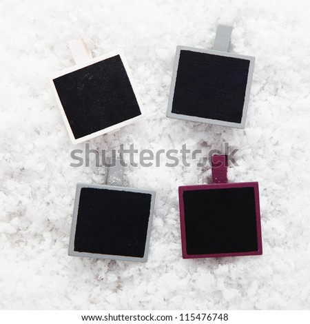 Four empty retro instant photo frames on snow for your collection of Christmas or seasonal images or messages - stock photo