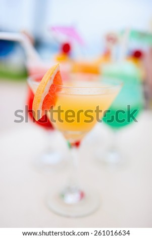Four exotic cocktails in a tropical setting - stock photo