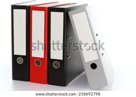four file folders in a row for storage - stock photo