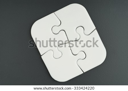 Four finished white square puzzle can place text on it on  background - solution, teamwork, business and challenge concept - stock photo
