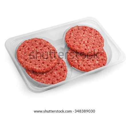 Four fresh hamburger slices in packaging tray isolated, top view - stock photo