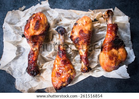 Four fried chicken legs with honey and spices,selective focus  - stock photo