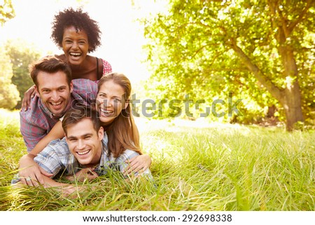 Four friends having fun together in the countryside