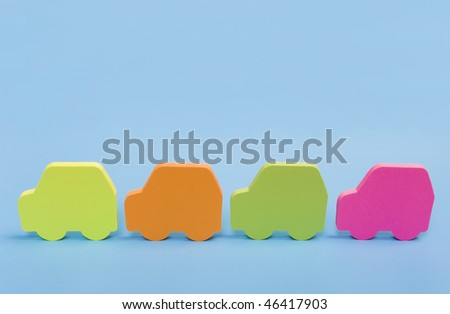 four funny colorful cars isolated on a blue background