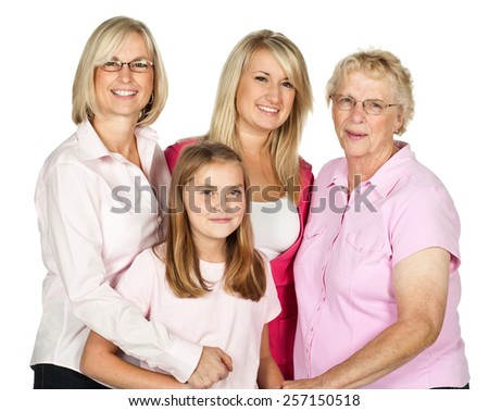 Four generations of females in a family portrait isolated on white. - stock photo