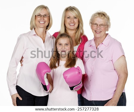 Four generations of females in a family portrait isolated on white with the youngest wearing boxing gloves - stock photo