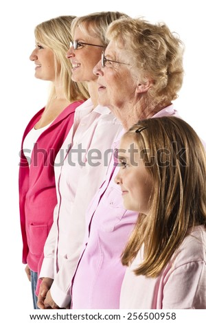Four generations of women in a family lined up against a white background. - stock photo