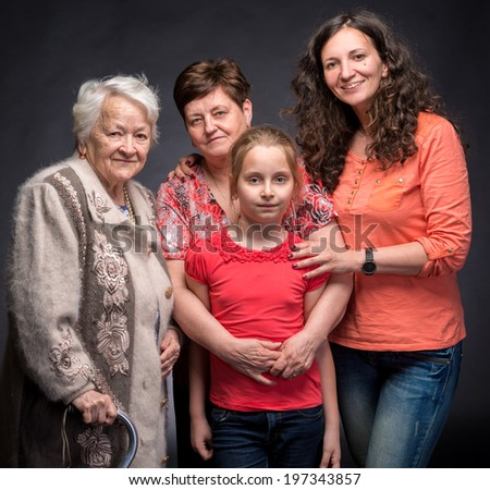 Four generations of women on a dark background