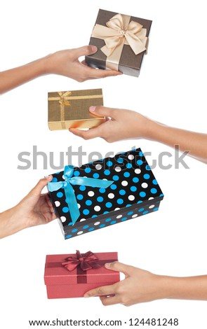 Four gifts being given back and forth isolated on a white background. - stock photo