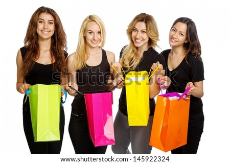 Four girls looking into shopping bags on white background