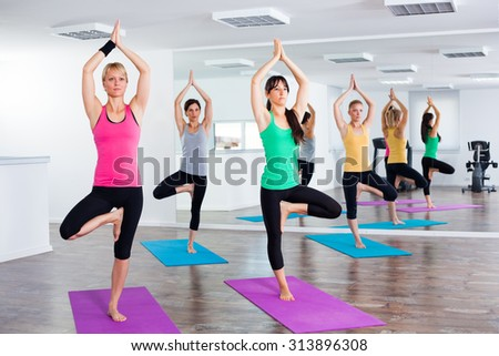 Four girls practicing yoga, Yoga - Vrikshasana / Tree pose