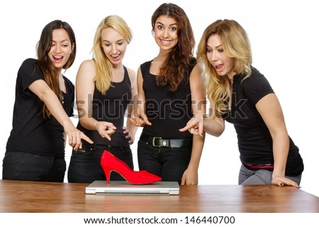 Four girls with laptop and red shoe on white background - stock photo