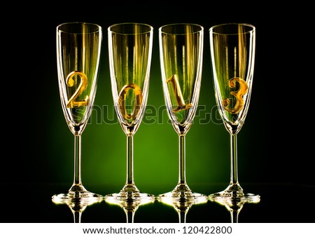 four glass goblet for champagne with  numeral 2013,  beautiful celebrations  New Year concept photo - stock photo
