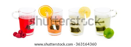 Four glasses with fruit tea - various tastes, different colors - on white background