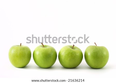 Four green apples in a row