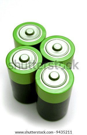 Four green batteries on white background.