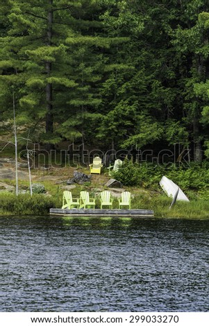 Four green chairs on a dock