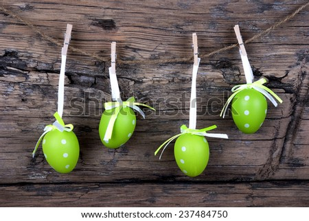 Four Green Easter Eggs Hanging On A Line On Wooden Background, Vintage,  Old Fashion, Rustic Or Retro Style - stock photo