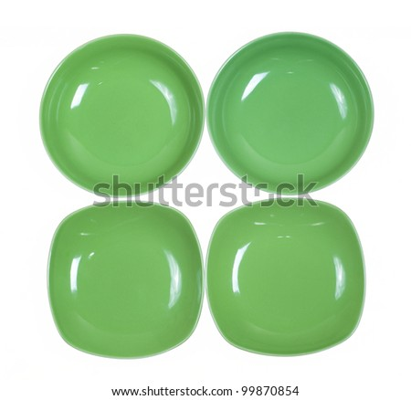 Four green plates on white background