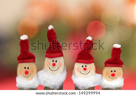 four handmade dwarfs against blurred background, christmas decoration - stock photo