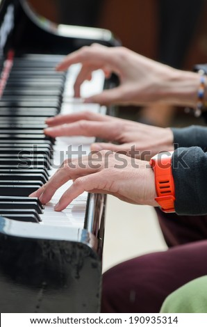 Four hands - stock photo