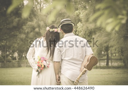 Four hands move backward wedding Vintage blurred background. - stock photo