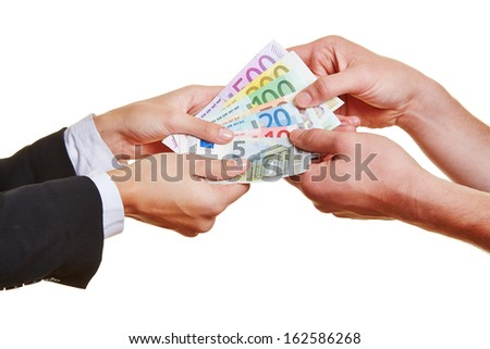 Four hands pulling on different Euro money bills in an argument - stock photo