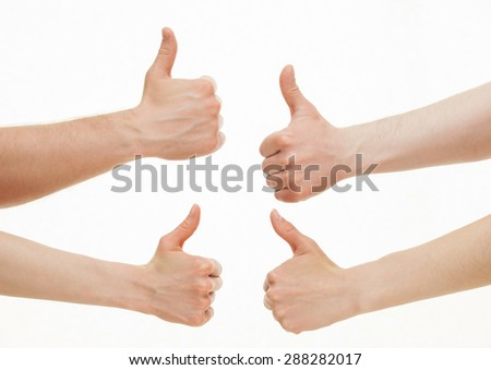 Four hands showing  thumb up signs on white background