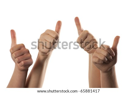 Four hands with their thumbs raised up. White background - stock photo
