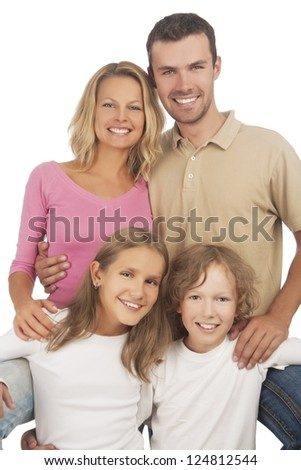 four happy caucasian family members standing together and smiling against white background. vertical shoot - stock photo
