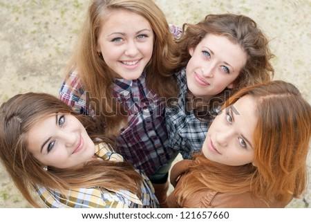 Four happy teen girls friends - stock photo