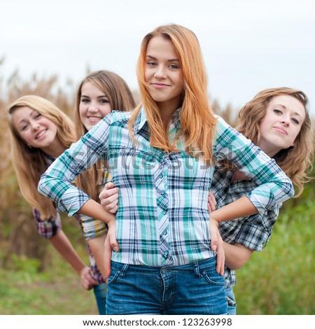 Four happy teenage girls friends - stock photo