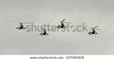 Four helicopter in formation - stock photo