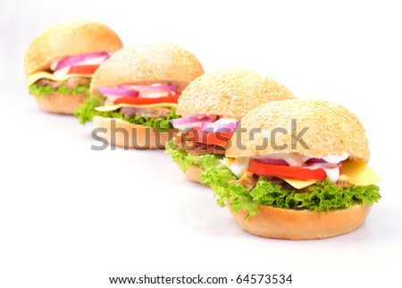 four homemade hamburgers isolated on white background - stock photo