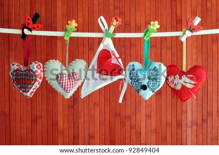 Four homemade sewn hearts and knickers hanging on a line - stock photo