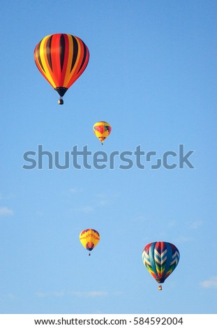 Four Hot Air Balloons Flying Close Together