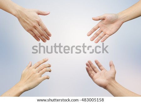 four human hand reaching together for international peace day concept:give empower positive power safe living:medical heal people:friendship relationship:liberty and freedom:generous:empower:heartily