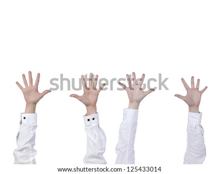 Four human hands raised over the white background - stock photo