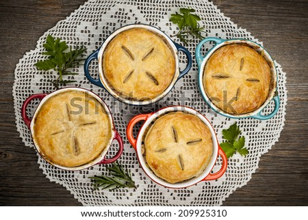 Four individual size meat pot pies from above