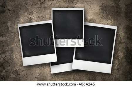 four instant photos on a grunge background - stock photo