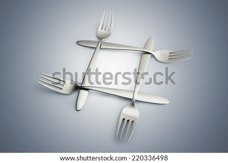 Four interlaced silver forks on blue gradient background - clipping path