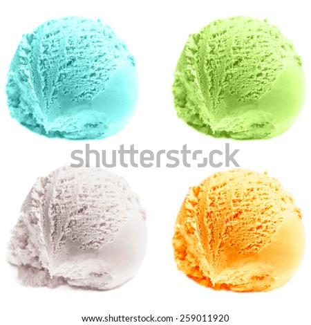 Four isolated scoops of ice cream. Mixed Scoops of green tea, mint, ,  vanilla, mango Ice-Cream Balls Macro.  - stock photo